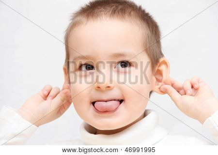 Happy Child Showing Tongue
