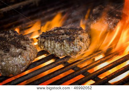 Hamburgers On A Flaming Grill