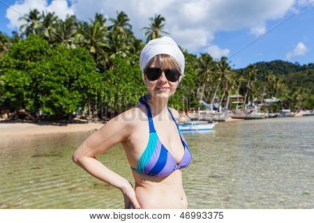 Woman Smiling On A Sunny Beach In Philippines