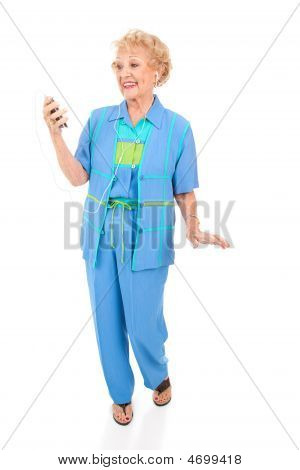 Senior Woman Listens To Mp3 Player
