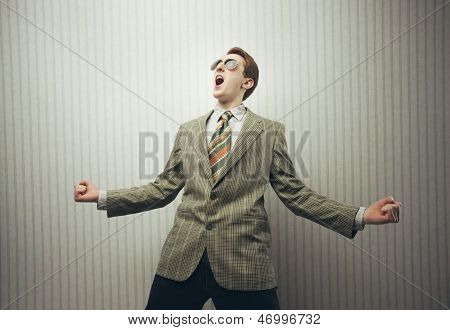 Happy Businessman Celebrating Success With Open Arms