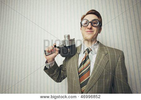 Nerdy Businessman With Old Fashioned Cine Camera