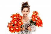 picture of saying sorry  - Guilty looking teenage girl seeking forgiveness with two bunches of fake flowers - JPG