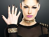 stock photo of thorns  - Beautiful face of fashion woman with black nails and bright makeup - JPG