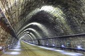 stock photo of tram  - A tram disappearing into a big tunnel - JPG