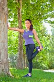 pic of hamstring  - Exercise woman stretching hamstring leg muscles during outdoor running workout - JPG