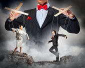 stock photo of execution  - Image of young businessman puppeteer - JPG