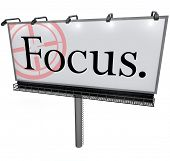A large white billboard with the word Focus and a target reticle to illusstrate the importance of fo