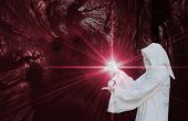 stock photo of sorcerer  - White Wizard manipulating Crystal balls on moody background - JPG