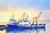 pic of lofoten  - fishing boats under a sunset in a fishing harbor - JPG