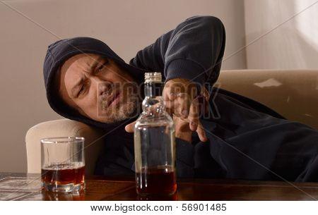 Man drinks whiskey
