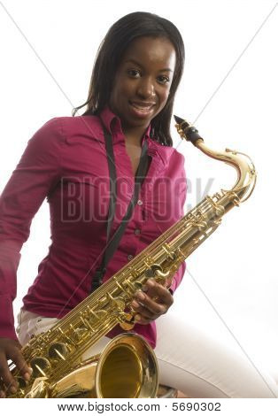 Young African American Girl Playing Saxophone Music