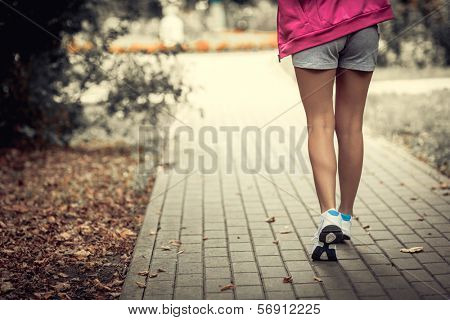 Young athletic legs in sneakers