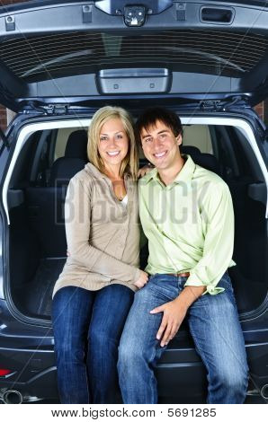 Couple Sitting In Back Of Car