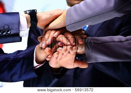 Closeup Of A Business Colleagues With Their Hands Stacked