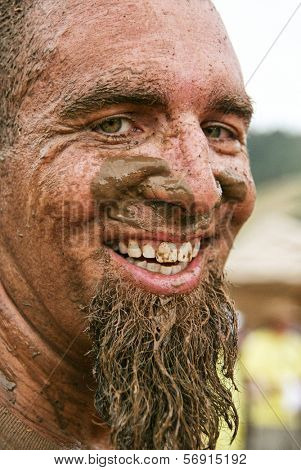 a man with a very muddy face
