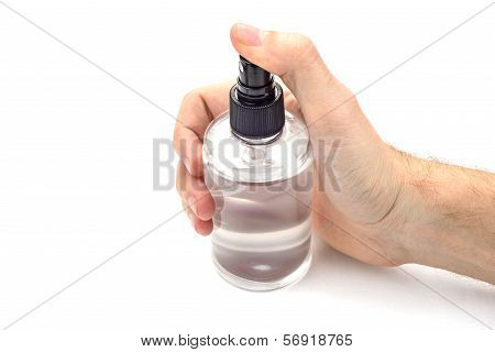Hand Holding Transparent Spray Can