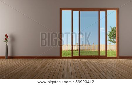 Empty Living Room With Open Sliding Window