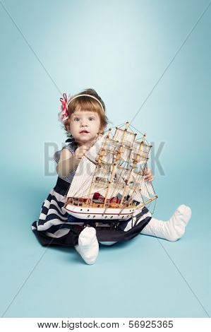 cute girl sailor with model ship