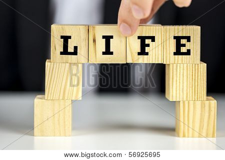 Bridge Of Cubes With Word Life Written On Them