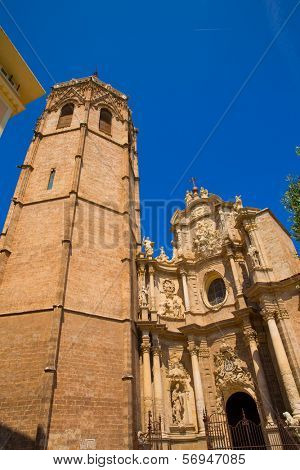Valencia Cathedral facade and Miguelete Micalet in Plaza de la Reina at Spain