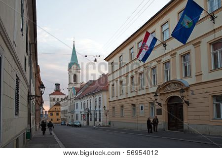 ZAGREB, CROATIA - JANUARY 12, 2014: Cirilometodska street that leads to famous St Mark�s Church and Lotrscak Tower at sunset.