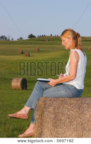 Woman working on a haystack