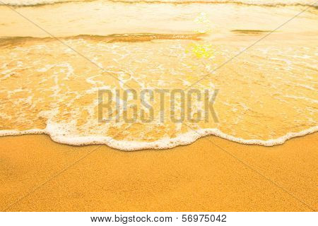 Soft wave of the sea, beach sand texture.