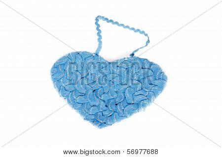 Heart shape of interwoven blue braid
