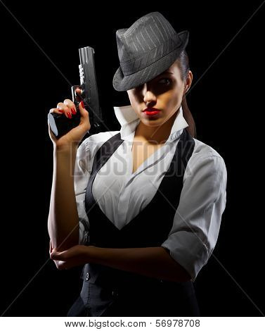 Dangerous and beautiful criminal girl with gun isolated
