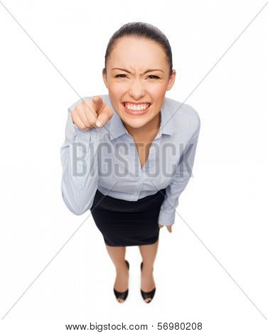 business and emotion concept - angry businesswoman pointing finger at you
