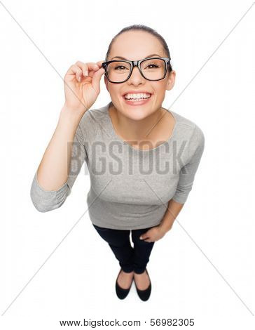 happiness, health and vision concept - smiling asian woman touching eyeglasses