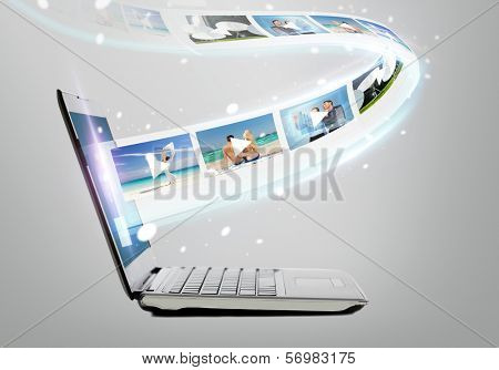 technology, internet and video concept - laptop computer with video on screen