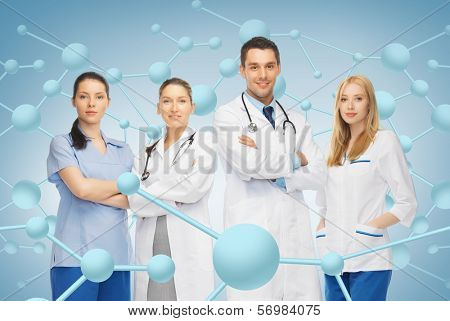 healthcare, research, science, chemistry and medicine concept - young team or group of doctors