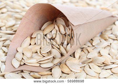 Pumpkin seeds in paper cornet close up