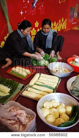 People With Traditional Vietnamese Dress Making Banhtet For  Lunar New Year