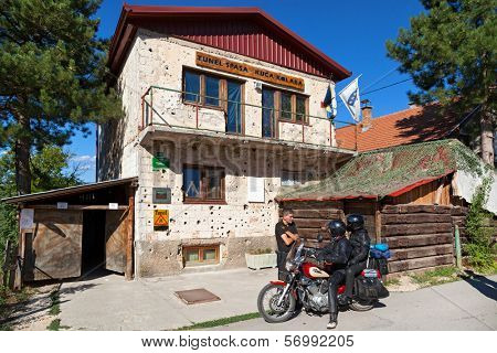 SARAJEVO, BOSNIA AND HERZEGOVINA - AUGUST 12, 2012: Tourists in front of Sarajevo Tunnel Museum. Constructed by the Bosnian Army during the war to link the city with the Bosnian-held territory.