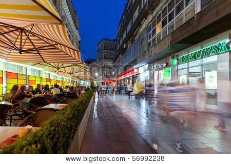 SARAJEVO, BOSNIA AND HERZEGOVINA - AUGUST 13, 2012: Street life at night crowded with tourists.