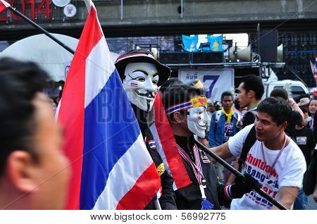 Bangkok-january 13: Unidentified Protestor Wearing White Mask  In Anti-government Group On Rama 4 St