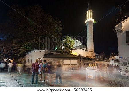 SARAJEVO, BOSNIA AND HERZEGOVINA - AUGUST 13, 2012: Ferhadija mosque and street life at night crowded with tourists.