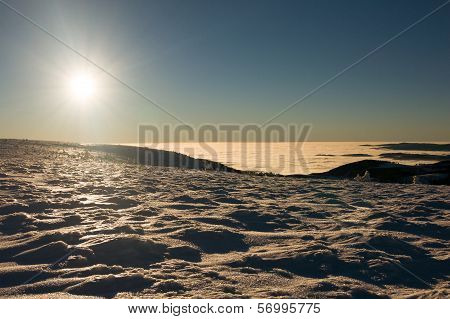 View of a sunset on winter mountain ridge