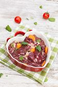 image of giblets  - Raw chicken liver in heart shaped bowl. High angle view. ** Note: Shallow depth of field - JPG