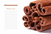 image of bundle  - Bundle of cinnamon sticks closeup isolated on white background with text - JPG