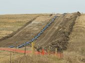 stock photo of pipeline  - A natural gas pipeline being constructed in North Dakota - JPG