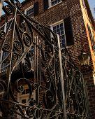 picture of ironworker  - Ironwork gate outside brick house in Charleston - JPG
