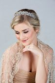 pic of tight dress  - Beautiful blond bride wearing gold dress and diamond tiara as well as a solitare wedding ring on studio background - JPG