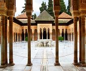 GRANADA, SPAIN - MARCH 11, 2013: Courtyard of the Lions in the Alhambra palace - masterpiece of moor