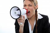 Woman shouting through a loudspeaker