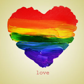 foto of bisexual  - the word love and a rainbow heart painted on a beige background - JPG