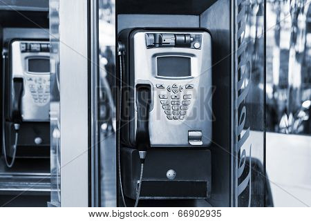 modern payphone on a city street